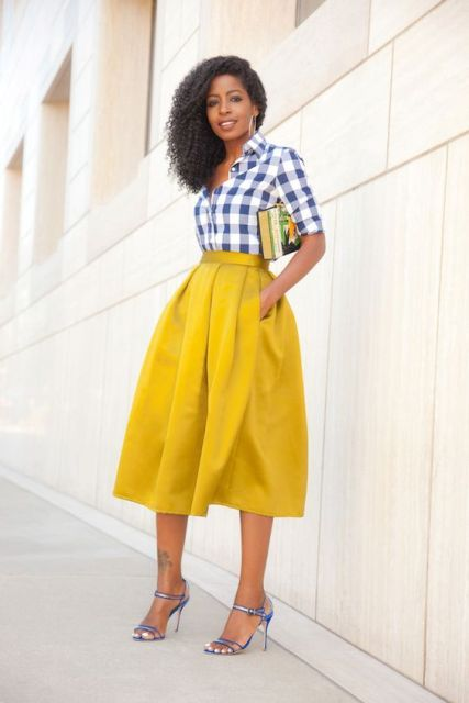 With yellow A-line midi skirt and sandals