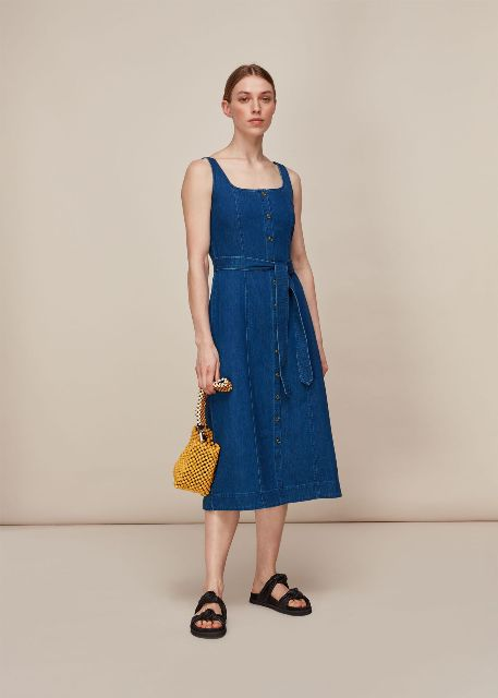 With yellow bag and black flat sandals