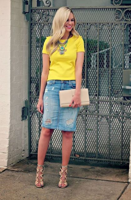 With yellow t-shirt, beige leather clutch and beige lace up high heels
