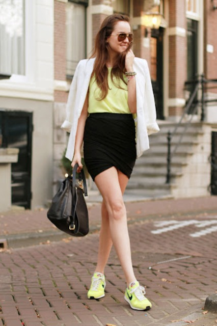 With yellow top, black skirt, white blazer and black leather bag