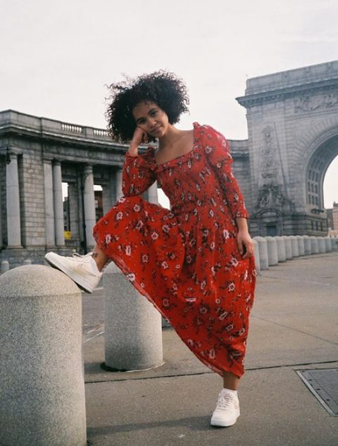 a beautiful red floral maxi dress with a square neckline and puff sleeves and white sneakers are a formula of a cool look