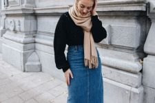 a black jumper, a blue denim midi skirt, black booties, a tan scarf for a stylish and comfy fall look