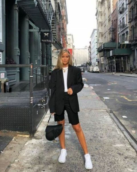 a black oversized blazer, black Bermuda shorts, a white tee, white trainers, a black saddle bag for work