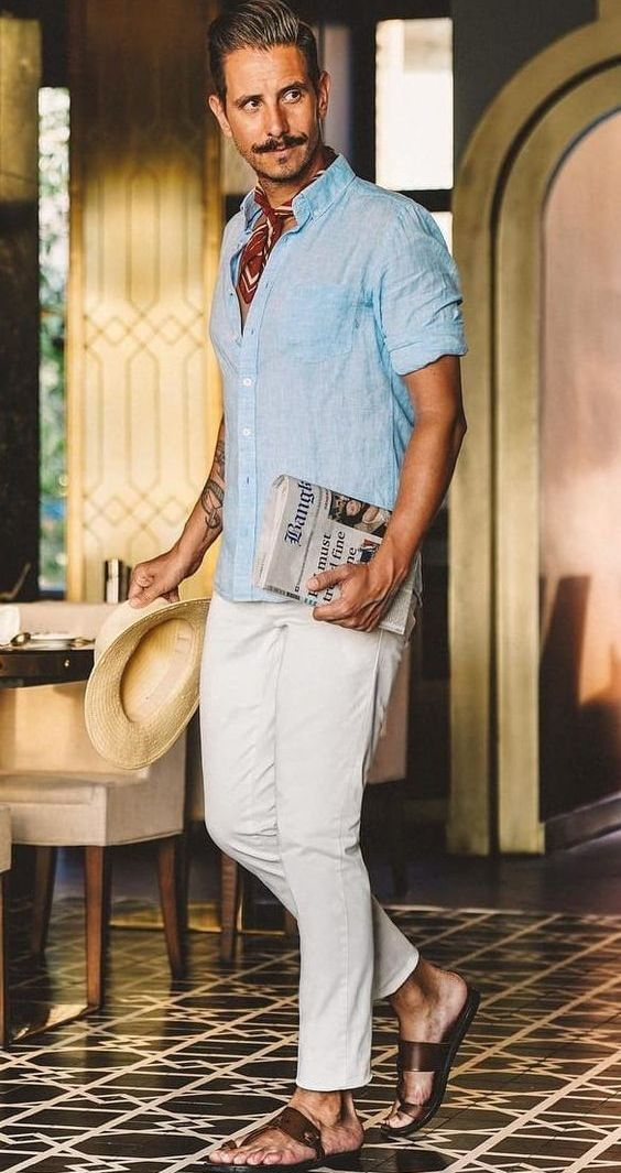 a blue linen shirt, white jeans, brown sandals and a bright neck tie plus a hat are cool for a hot day in summer