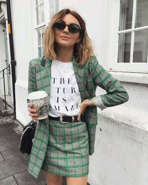 a bold grey and gren plaid skirt suit with a mini, a printed tee, a black belt and a black bag plus statement earrings