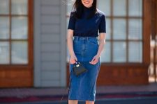 a chic look with a navy short sleeve turtleneck, a blue high waist denim pencil skirt, nude mules and a black bag