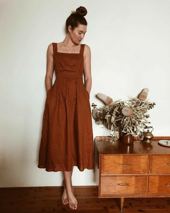 a comfortable rust-colored linen midi sundress with thick straps, a square neckline and pockets is a very cool idea