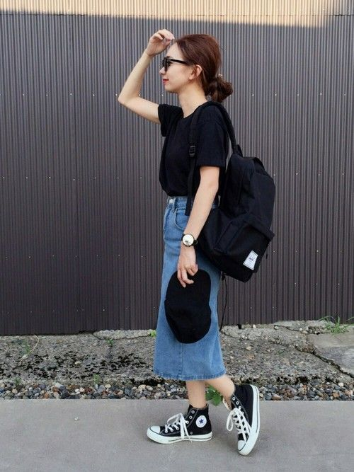 a comfy look with a black tee, a blue denim midi, black sneakers, a black baseball cap and a backpack for every day