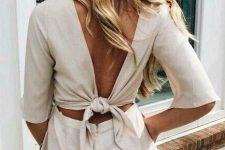 a cool two piece set with a linen crop top with a tied up back and short sleeves and a high waisted mini skirt is amazing