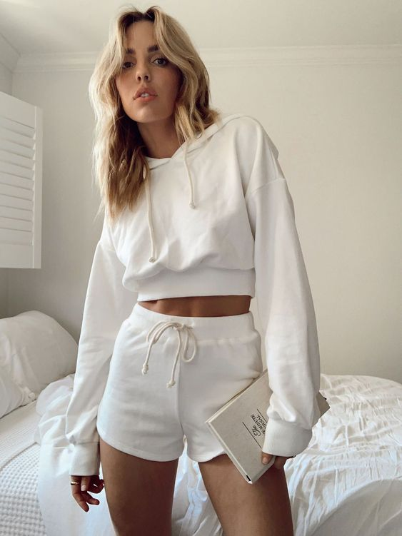 a creamy homewear set of a cropped hoodie and shorts can be worn outside for sport or going to grocery's too