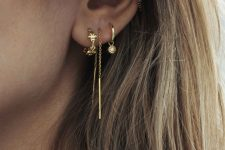 a dreamy look with a stacked lobe piercing and a double helix one all done with cool gold hoops
