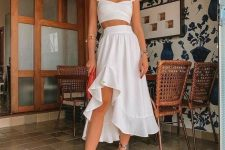 a feminine vacation set with a ruffle strap crop top, a ruffle midi skirt, colorful shoes and round sunglasses