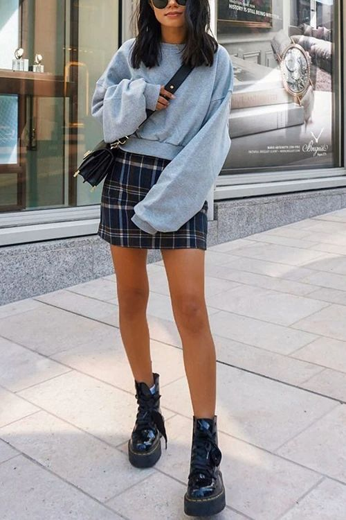 a grey cropped hoodie, a navy plaid mini skirt, black lacquer boots and a black bag for the fall