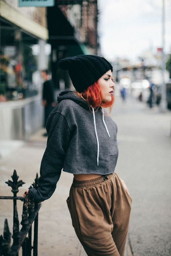 a grey cropped hoodie, tan sweatpants, a black beanie for a comfy sport chic look