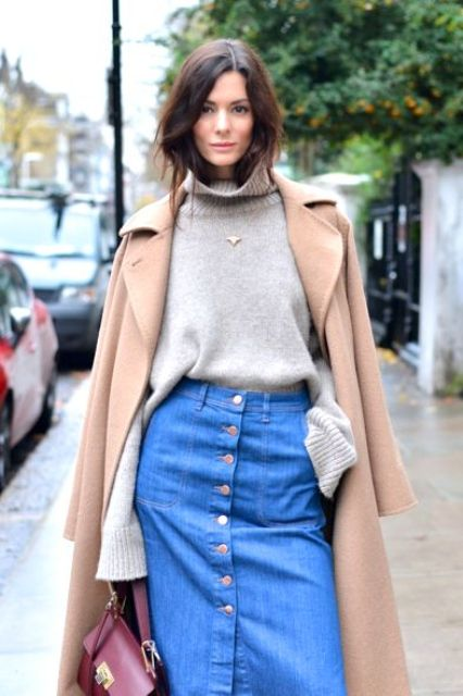 a grey jumper, a blue denim button up skirt, a tan coat and a burgundy crossbody bag for the fall