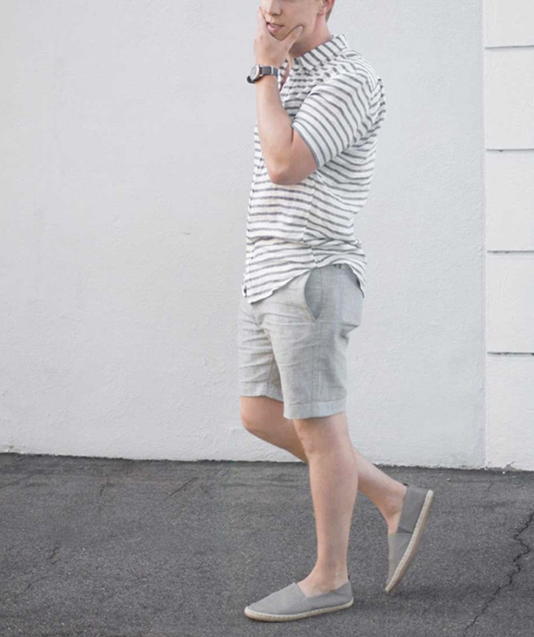 a grey short sleeve shirt, grey linen shorts, grey espadrilles for a comfortable hot day look
