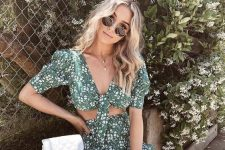 a lovely green floral print two piece set with a crop top with short sleeves and a high waisted mini skirt plus a white backpack