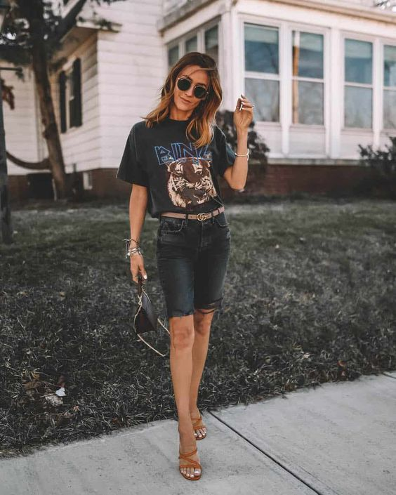 a lovely outfit with a black printed tee, black denim biker shorts, nude strappy heels, a black mini bag