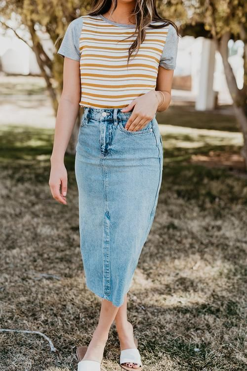 a modest look with a striped t-shirt, a blue denim midi, white slippers for a comfortable every day look