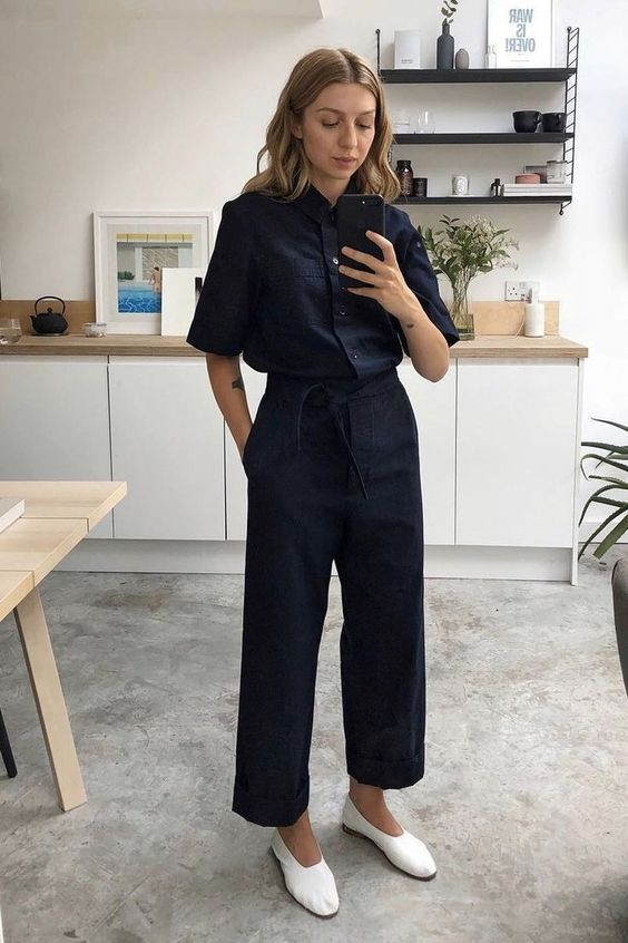 a navy jumpsuit with wide leg pants, white vintage-inspired shoes - just grab a tote and you are ready to go