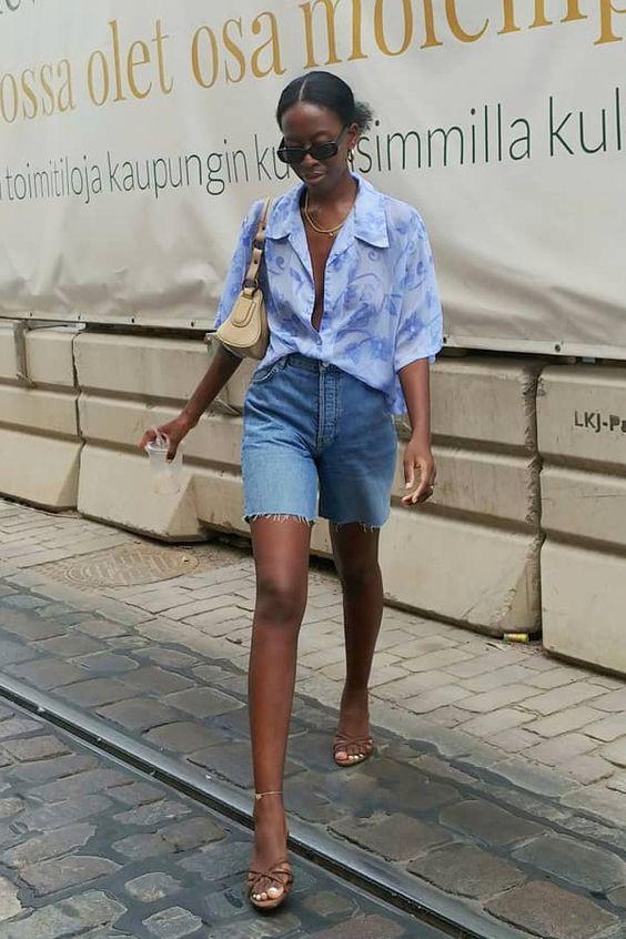 a pretty lilac tie-dye shirt, blue denim biker shorts, nude strappy heels and a neutral mini bag