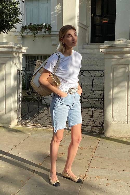 a relaxed summer look with a white tee, blue denim biker shorts, two tone flats and a straw bag