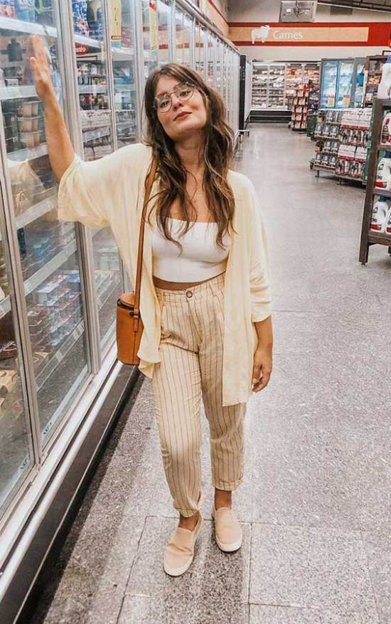 a simple everyday look with a white strapless crop top, yellow striped linen pants, a yellow wide sleeve shirt, an orange bag and blush slipons