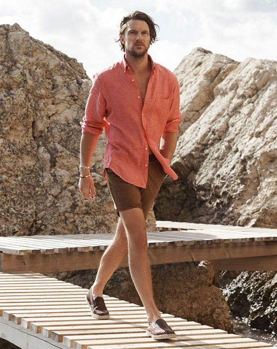 a simple summer outfit with a coral linen shirt, brown shorts, brown espadrilles will be a good idea for a hot day