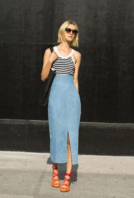 a striped strap top, a blue high waisted denim midi with a slit, ombre lace up sandals and a black tote for a bold statement
