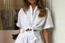 a stylish and simple linen set in white, with a tied up shirt and paperbag waist shorts is all you need for a hot summer