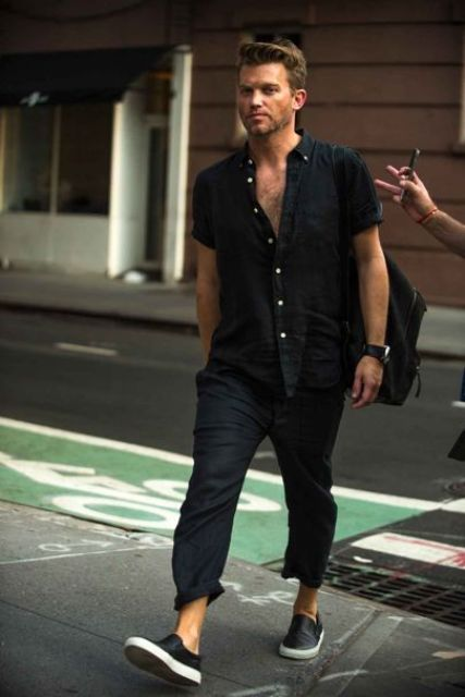 a total black look with a linen short sleeve shirt and pants plus slipons and a backpack is a cool idea