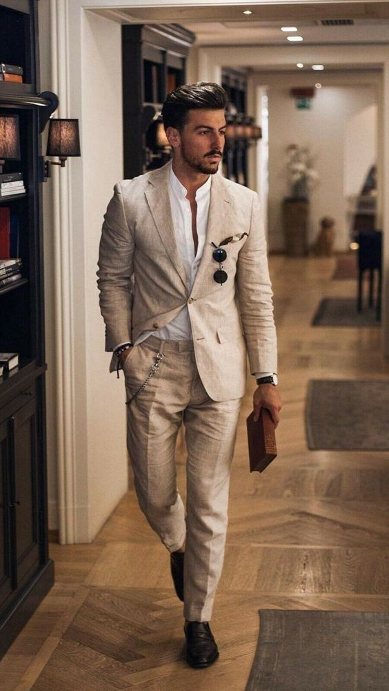 a total linen look with a white shirt and a tan pantsuit, brown shoes and elegant sunglasses for a cool office outfit