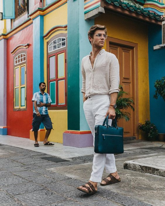 a very simple and cool summer look with a linen shirt and pants, brown sandals and a black bag is great for work with no strict dress code
