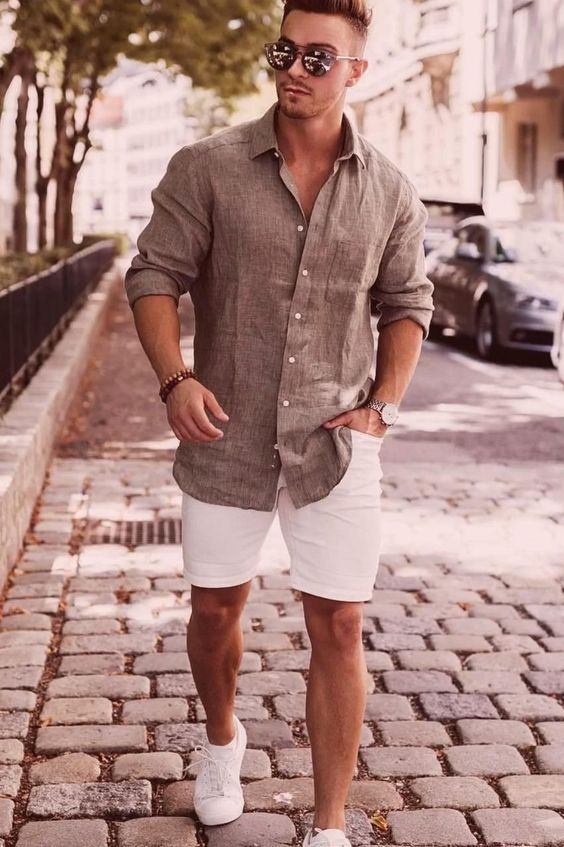 a very simple and stylish summer look with a grey linen shirt, white denim shorts and white sneakers is a cool idea