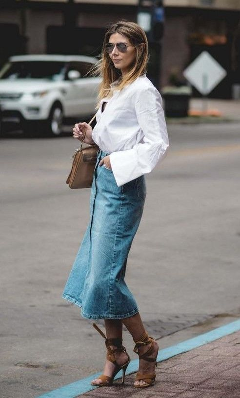 a white linen shirt, a blue denim midi skirt, brown lace up heels, a brown bag and sunglasses for a chic and relaxed look