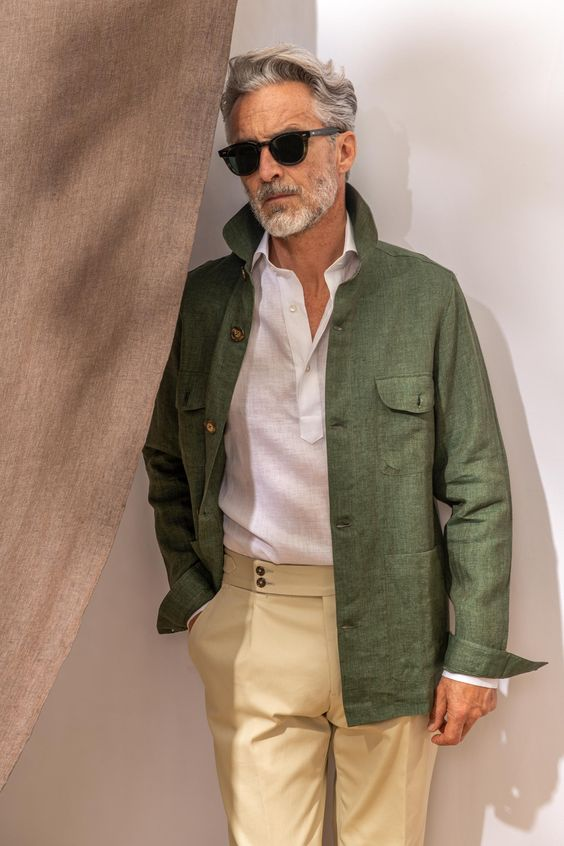 a white linen shirt, a green linen jacket and tan pants for a stylish and elegant summer look that is work-appropriate