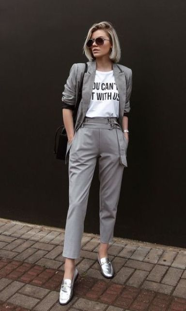 an easy and chic look with a grey pantsuit, a printed tee, a black bag and silver loafers that spruce up the whole look