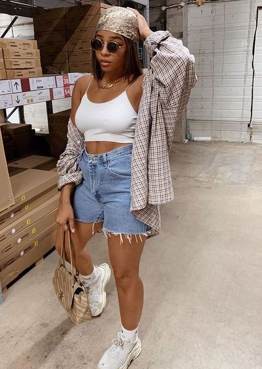 an everyday look with a white crop top, blue denim shorts, a plaid shirt, a headband, white socks and trainers plus a gold bag