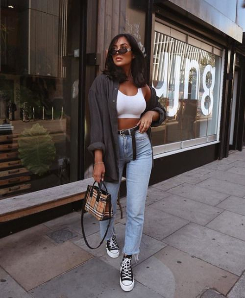 an everyday look with a white crop top, blue high waisted jeans, a graphite grey oversized shirt, a plaid bag and black sneakers