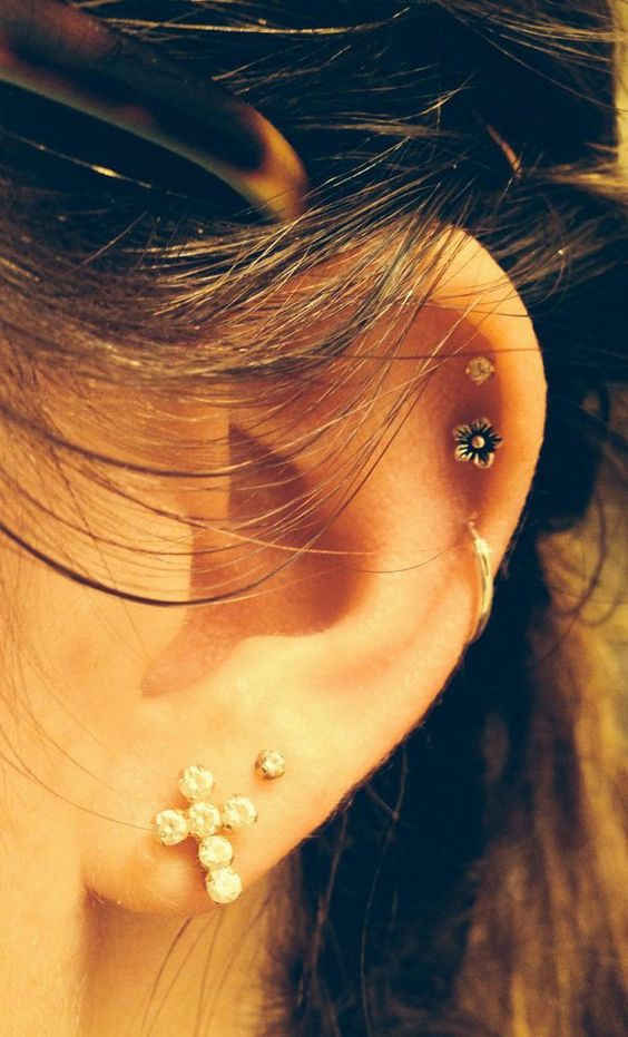 beautiful ear styling with stacked lobe and helix piercings done with studs and a hoop is a lovely idea to try