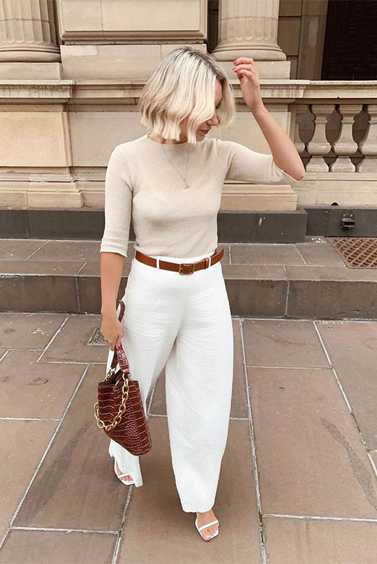 beige elbow sleeve knit top, white tapered pants, white strappy heels and a brown croc purse and a belt