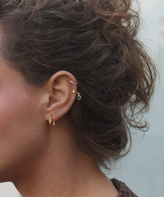 bold boho styling with a lobe, tragus and double helix piercing all done with hoop earrings