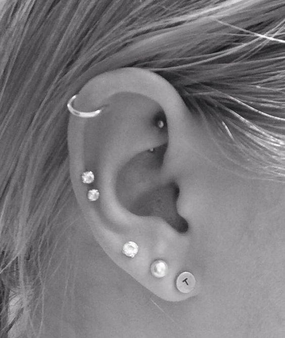 a trendy multiple ear piercing idea