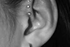 stylish stacked piercings – stacked foward helix ones plus an upper helix one and a lobe piercing are lovely