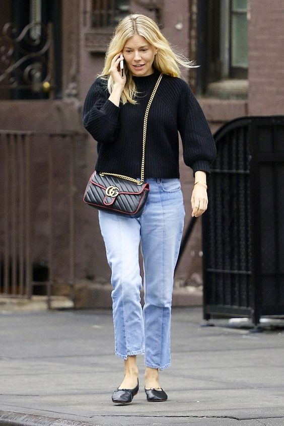 a black cropped sweater, blue jeans, black ballet flats and a black crossbody bag for a chic look