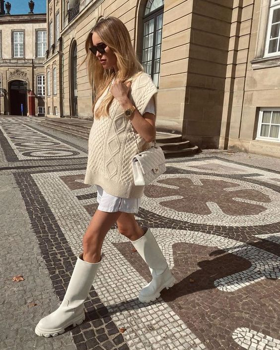 a creamy look with a white shirtdress, a creamy patterned waistcoat, creamy chunky boots and a bag for a comfy outfit