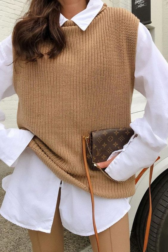 a lovely fall look suitable for work - an oversized white shirt, a tan knit vest, tanleggings and a brown printed bag