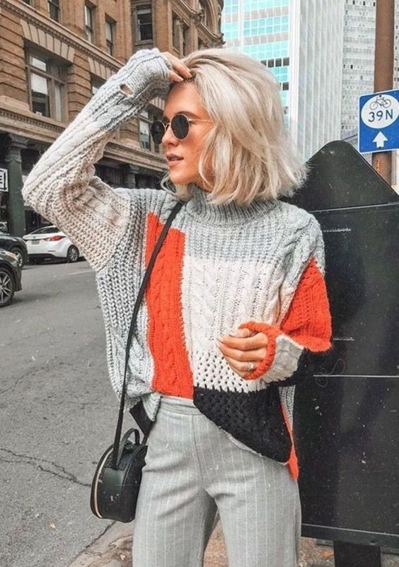 a color block chunky sweater, grey pinstripe trousers, a black round bag for a bright fall outfit