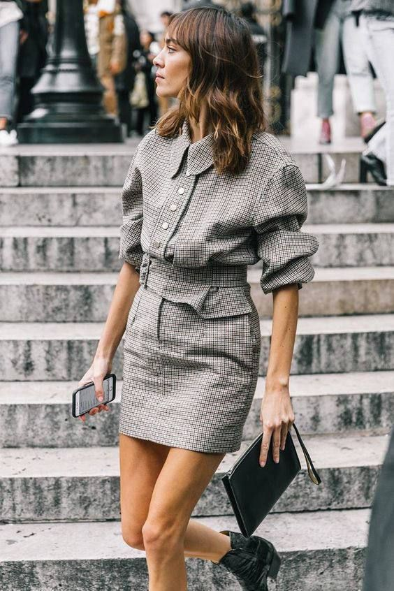 a lovely grey plaid mini dress with a retro feel, puff sleeves, a belt, black cowboy boots and a black clutch