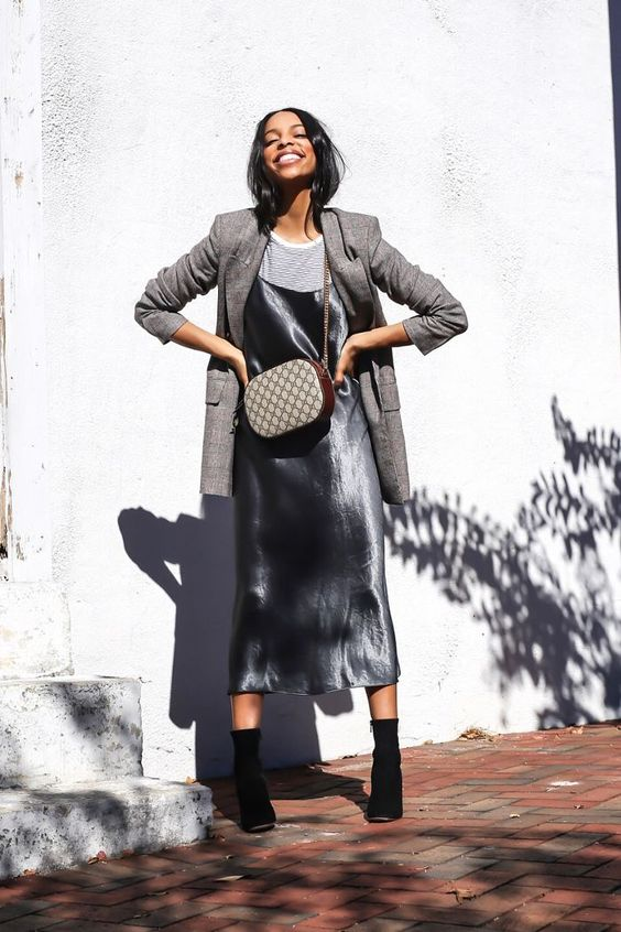 a striped tee, a silver slip midi dress, a grey plaid blazer, black sock boots and a printed bag